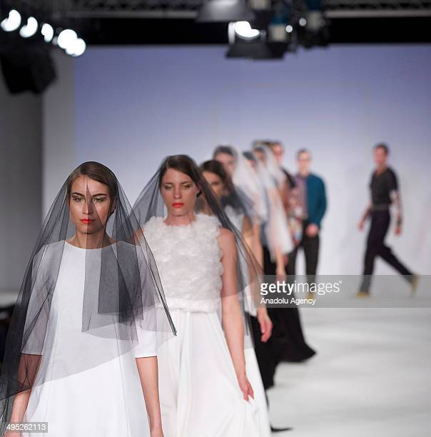 A model walks the runway during the Arts University Bournemouth show on the third day of the Graduate Fashion Week 2014 at the Old Truman Brewery on...
