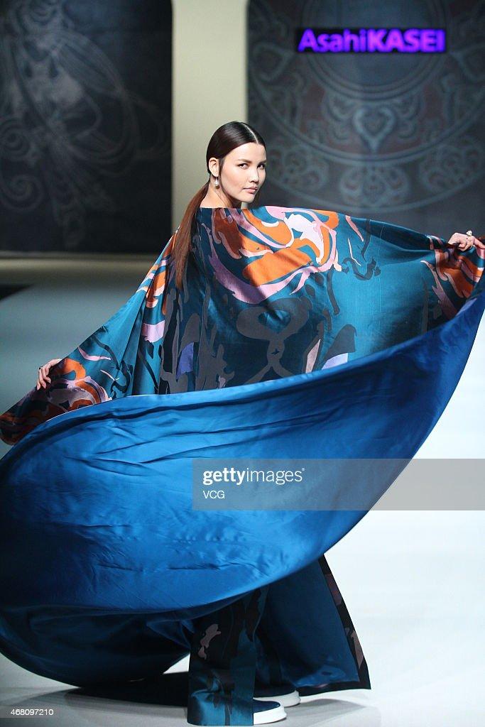 A model walks the runway during the Asahi Kasei Chinese Fashion Designer Creativity Award Zeng Fengfei Collection as part of MercedesBenz China...