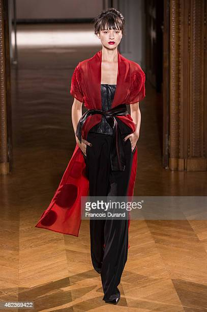 A model walks the runway during the Atelier Gustavolins show as part of Paris Fashion Week Haute Couture Spring/Summer 2015 on January 27 2015 in...