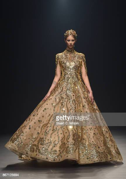 A model walks the runway during the Atelier Zuhra show at Fashion Forward October 2017 held at the Dubai Design District on October 27 2017 in Dubai...
