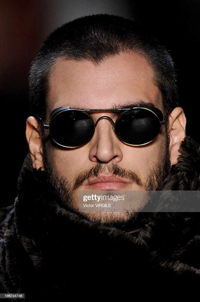 A model walks the runway during the Auslander Fall/Winter 2013 fashion show at Fashion Rio on November 09, 2012 in Rio de Janeiro, Brazil.