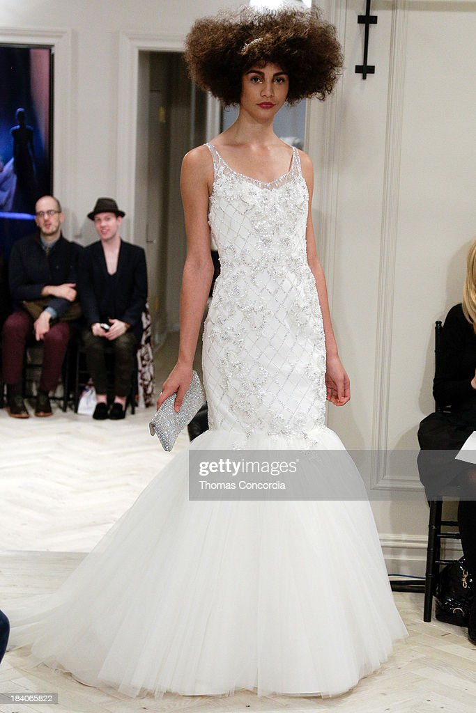 A model walks the runway during the Badgley Mischka Fall 2014 Bridal collection show on October 11, 2013 in New York City.