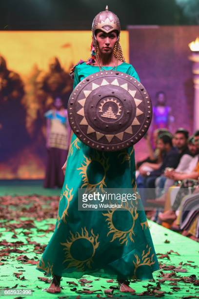 A model walks the runway during the Bahubali 2 fashion show held at Hotel Westin on April 7 2017 in Mumbai India