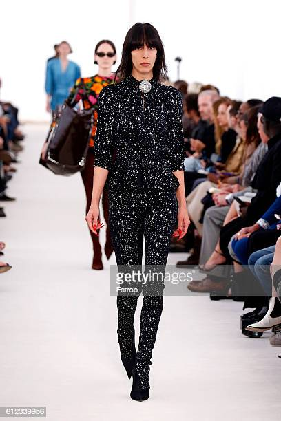 A model walks the runway during the Balenciaga designed by Demma Gvasalia show as part of the Paris Fashion Week Womenswear Spring/Summer 2017 on...