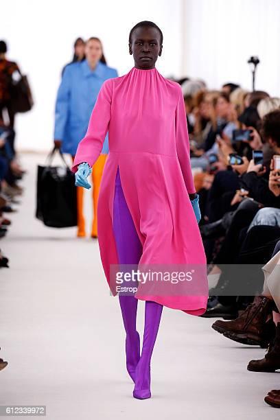 A model walks the runway during the Balenciaga designed by Demma Gvasalia show as part of the Paris Fashion Week Womenswear Spring/Summer 2017 on...