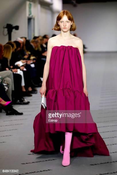 A model walks the runway during the Balenciaga designed by Demma Gvasalia show as part of the Paris Fashion Week Womenswear Fall/Winter 2017/2018 on...