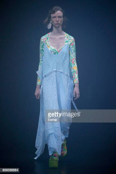 A model walks the runway during the Balenciaga show as part of the Paris Fashion Week Womenswear Spring/Summer 2018 on October 1 2017 in Paris France