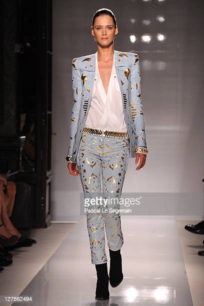 A model walks the runway during the Balmain Ready to Wear Spring / Summer 2012 show during Paris Fashion Week at the Grand Hotel Intercontinental on...