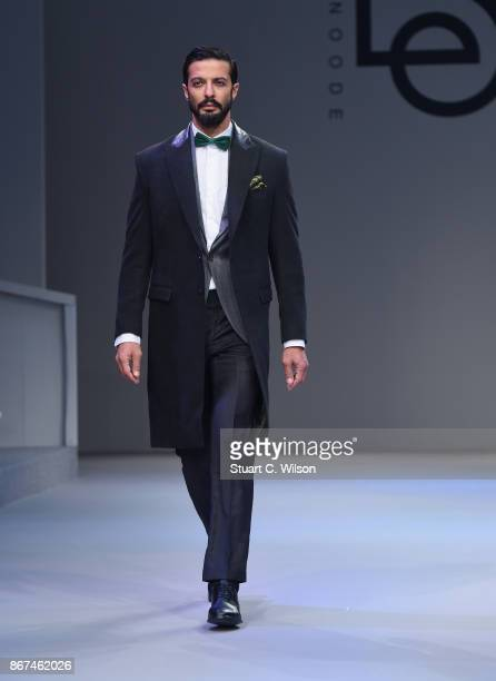 A model walks the runway during the Behnoode Menswear show at Fashion Forward October 2017 held at the Dubai Design District on October 28 2017 in...