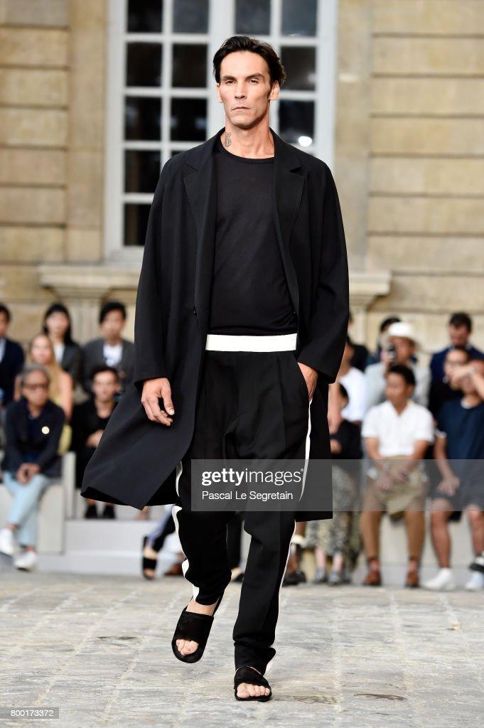 model-walks-the-runway-during-the-berluti-menswear-springsummer-2018-picture-id800173372