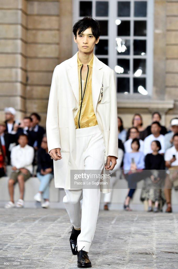 model-walks-the-runway-during-the-berluti-menswear-springsummer-2018-picture-id800173956