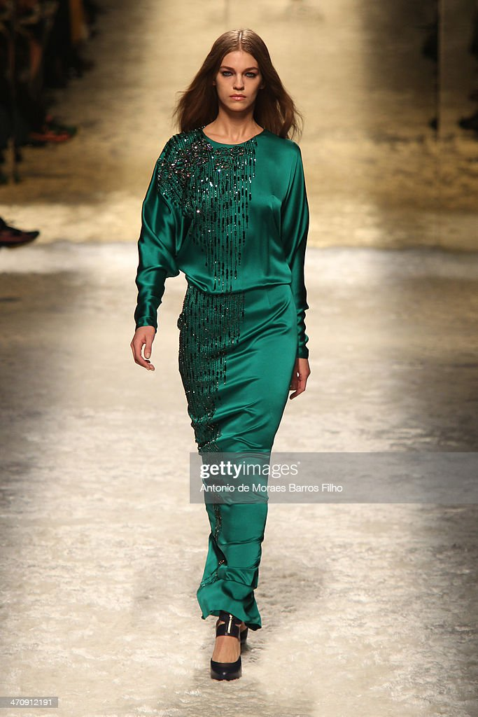 A model walks the runway during the Blumarine show as a part of Milan Fashion Week Womenswear Autumn/Winter 2014 on February 21, 2014 in Milan, Italy.