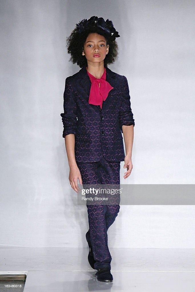 A Model walks the runway during the Bonnie Young Fall/Winter 2013 Fashion Show at Industria Superstudio on March 10, 2013 in New York City.