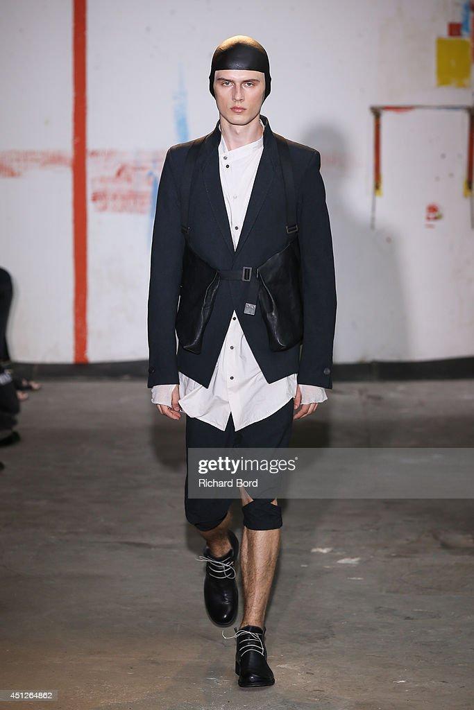 A model walks the runway during the Boris Bidjan Saberi show as part of the Paris Fashion Week Menswear Spring/Summer 2015 on June 26, 2014 in Paris, France.