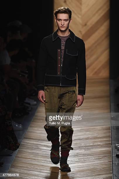 A model walks the runway during the Bottega Veneta fashion show as part of Milan Men's Fashion Week Spring/Summer 2016 on June 21 2015 in Milan Italy