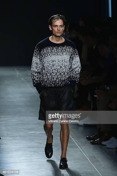 A model walks the runway during the Bottega Veneta show as part of Milan Fashion Week Menswear Spring/Summer 2015 on June 22 2014 in Milan Italy
