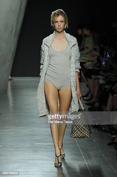 A model walks the runway during the Bottega Veneta Show as part of Milan Fashion Week Womenswear Spring/Summer 2015 on September 20 2014 in Milan...