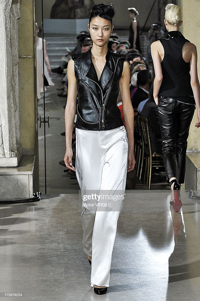 A model walks the runway during the Bouchra Jarrar show as part of Paris Fashion Week HauteCouture Fall/Winter 20132014 at the Musee Bourdelle on...