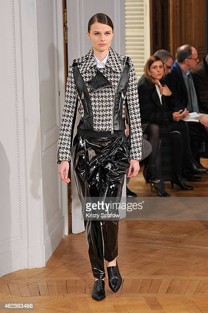 A model walks the runway during the Bouchra Jarrar show as part of Paris Fashion Week Haute Couture Spring/Summer 2015 on January 27 2015 in Paris...