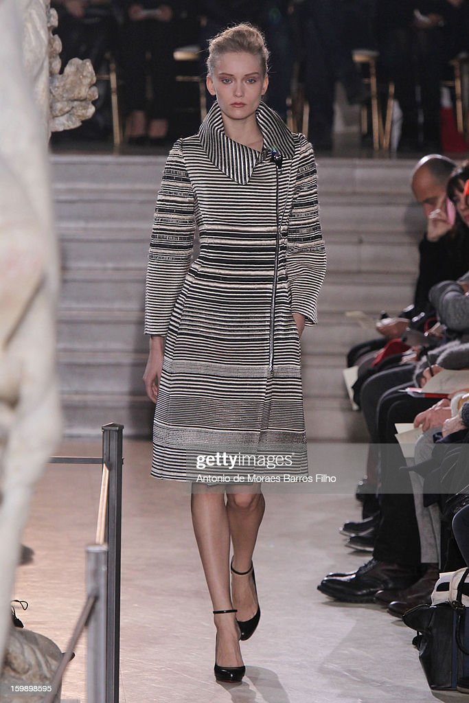 A model walks the runway during the Bouchra Jarrar Spring/Summer 2013 HauteCouture show as part of Paris Fashion Week at Musee Bourdelle on January...