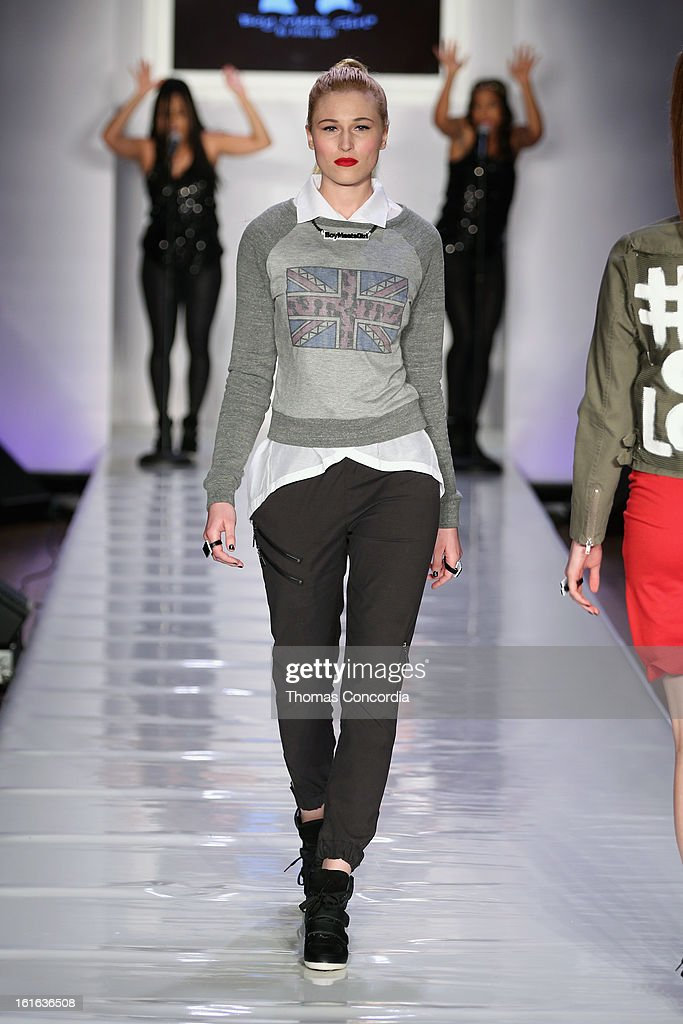 A model walks the runway during the Boy Meets Girl by Stacy Igel the 'Invasion Collections' Fashion Show at STYLE360 presented by Conair Fashion Pavilion on February 13, 2013 in New York City.