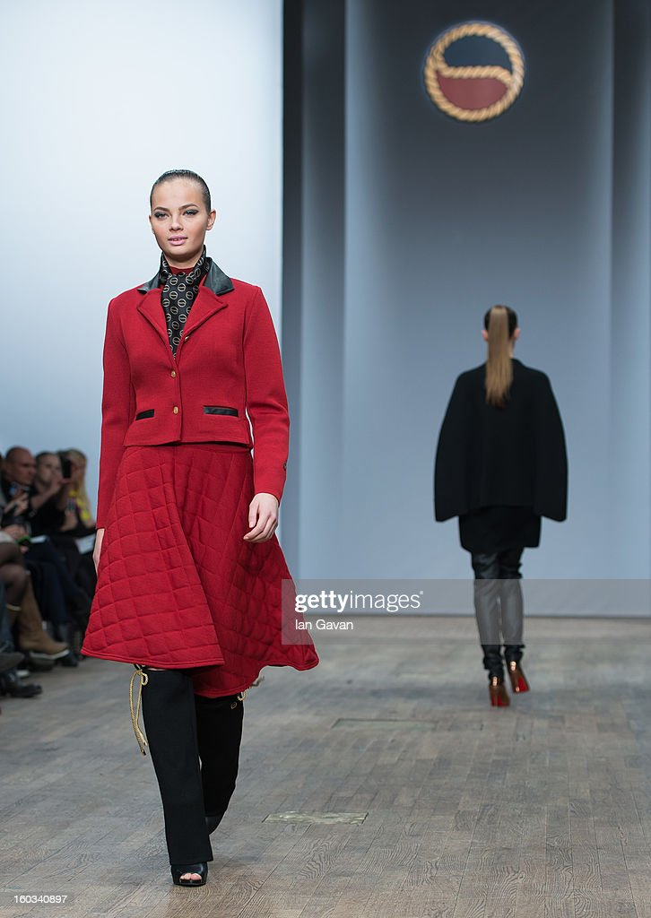 A model walks the runway during the Busnel show at Mercedes-Benz Stockholm Fashion Week Autumn/Winter 2013 at Berns on January 29, 2013 in Stockholm, Sweden.