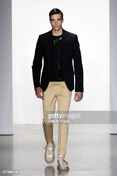 A model walks the runway during the Calvin Klein Collection fashion show as part of Milan Men's Fashion Week Spring/Summer 2016 on June 21 2015 in...