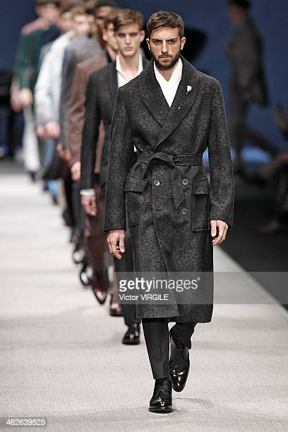 A model walks the runway during the Canali show as a part of Milan Fashion Week Menswear Autumn/Winter 2014 on January 13 2014 in Milan Italy