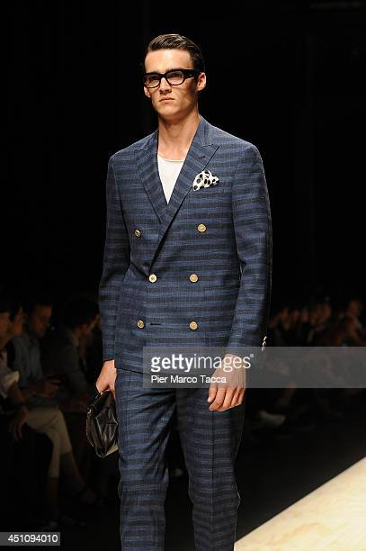 A model walks the runway during the Canali show as part of Milan Fashion Week Menswear Spring/Summer 2015 on June 23 2014 in Milan Italy