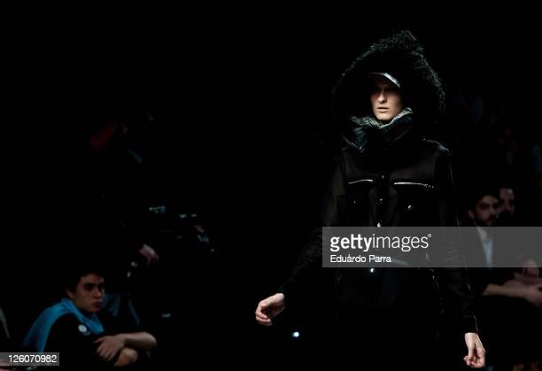 A model walks the runway during the Carlos Diez Fashion Show as part of Cibeles Fashion Week A/W 2011 on February 22 2011 in Madrid Spain