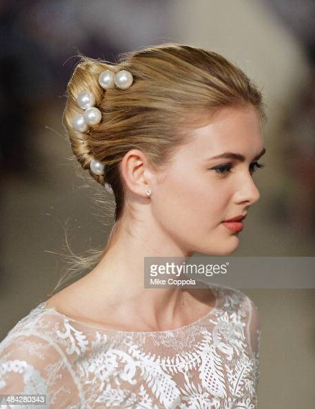 A model walks the runway during the Carolina Herrera Spring 2015 Bridal collection show at on April 11 2014 in New York City