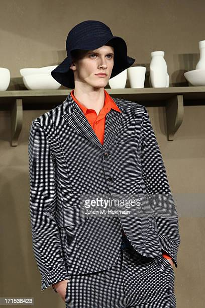 A model walks the runway during the Carven Menswear Spring/Summer 2014 show as part of the Paris Fashion Week on June 26 2013 in Paris France