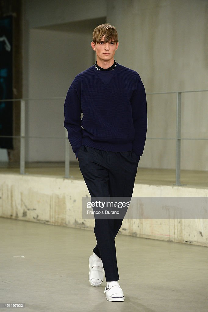 A model walks the runway during the Carven show as part of the Paris Fashion Week Menswear Spring/Summer 2015 on June 25, 2014 in Paris, France.