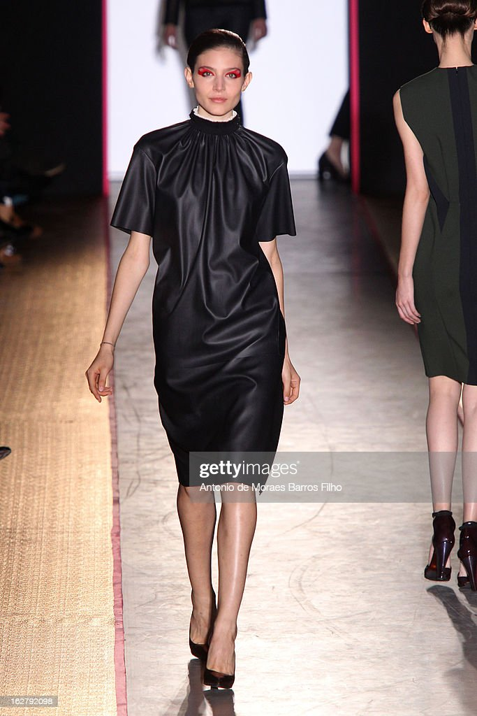 A model walks the runway during the Cedric Charlier Fall/Winter 2013 Ready-to-Wear show as part of Paris Fashion Week on February 26, 2013 in Paris, France.