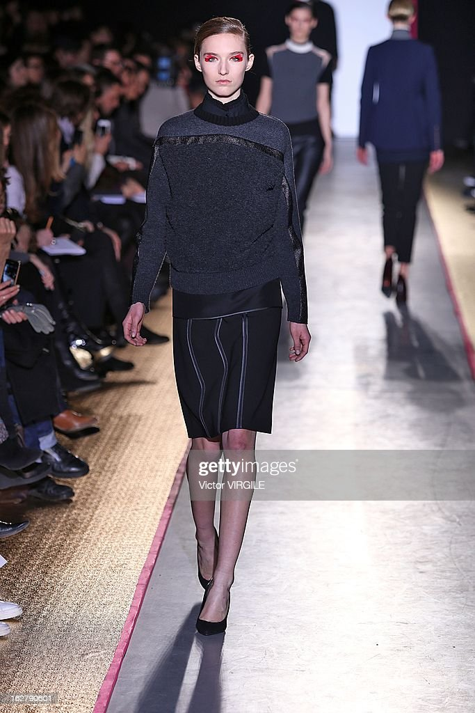 A model walks the runway during the Cedric Charlier Fall/Winter 2013/14 Ready-to-Wear show as part of Paris Fashion Week on February 26, 2013 in Paris, France.