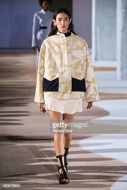 A model walks the runway during the Cedric Charlier show as part of the Paris Fashion Week Womenswear Spring/Summer 2016 at Cite de la Mode et du...
