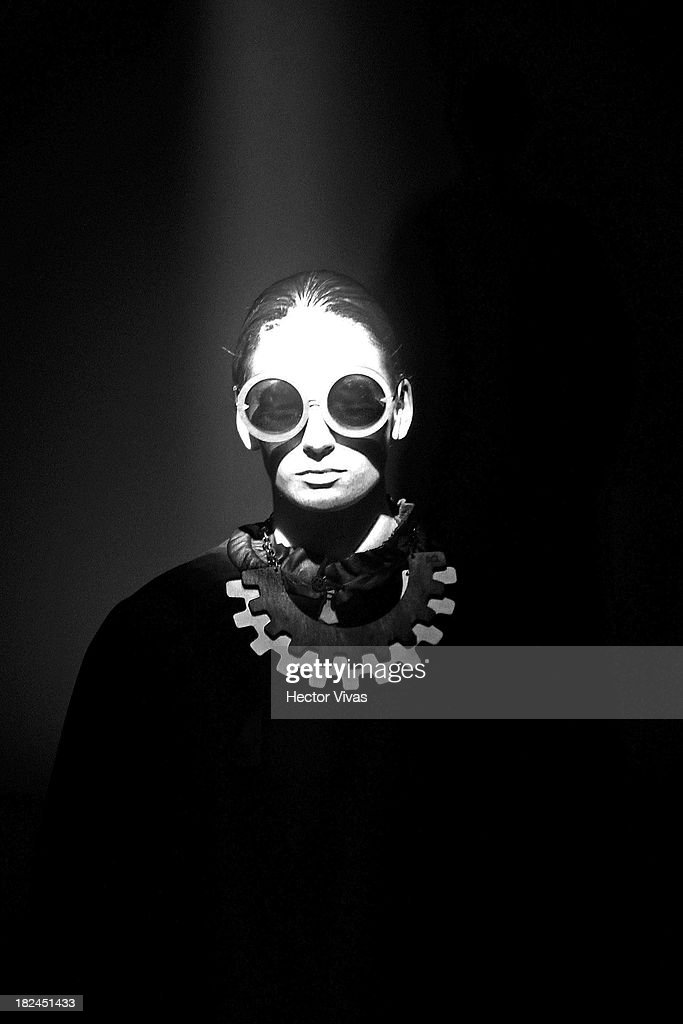 A model walks the runway during the Centro show at Mercedes Benz Fashion Week Mexico 2013 on September 29, 2013 in Mexico City, Mexico.
