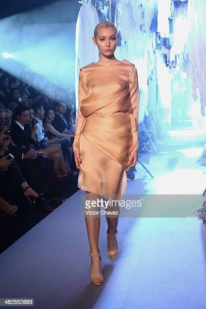 A model walks the runway during the Centro show at MercedesBenz Fashion Week Mexico Autumn/Winter 2014 at Campo Marte on April 3 2014 in Mexico City...