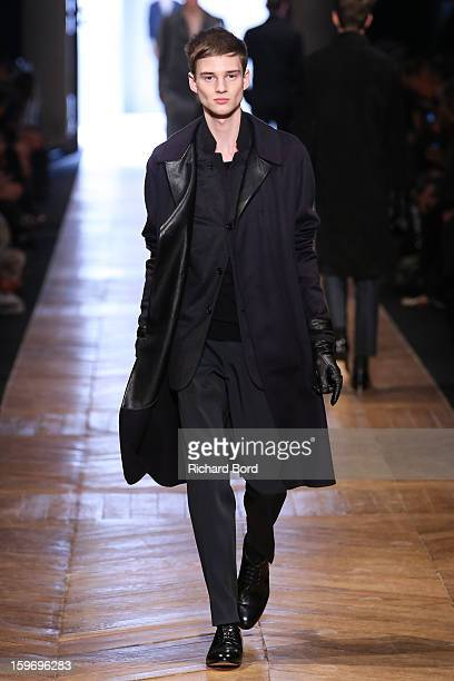 A model walks the runway during the Cerruti Men Autumn / Winter 2013 show as part of Paris Fashion Week on January 18 2013 in Paris France