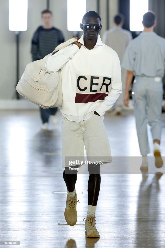 model-walks-the-runway-during-the-cerruti-menswear-springsummer-2018-picture-id800469352