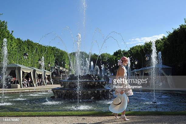 A model walks the runway during the Chanel 2012/13 Cruise Collection at Chateau de Versailles on May 14 2012 in Versailles France