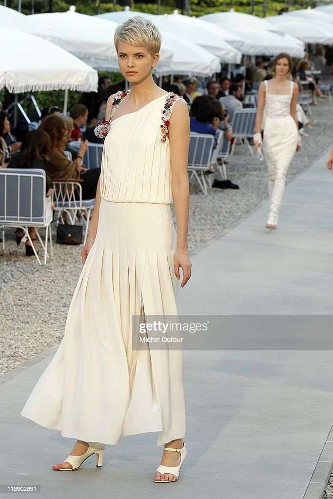 A model walks the runway during the Chanel Collection Croisiere at Hotel du Cap on May 9, 2011 in Cap d'Antibes, France.