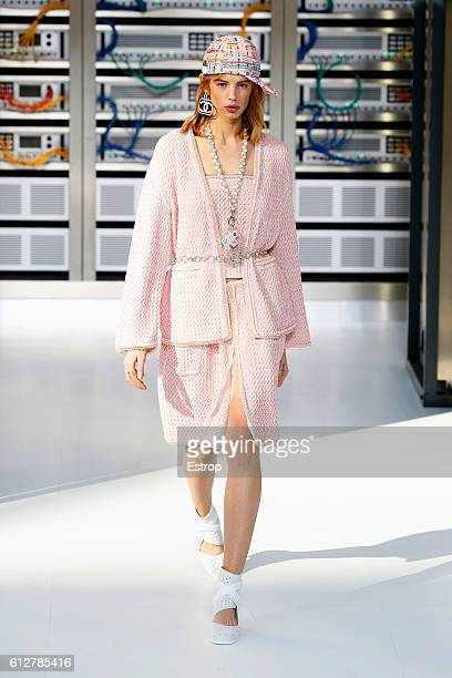 A model walks the runway during the Chanel designed by Karl Lagerfeld show as part of the Paris Fashion Week Womenswear Spring/Summer 2017 on October...