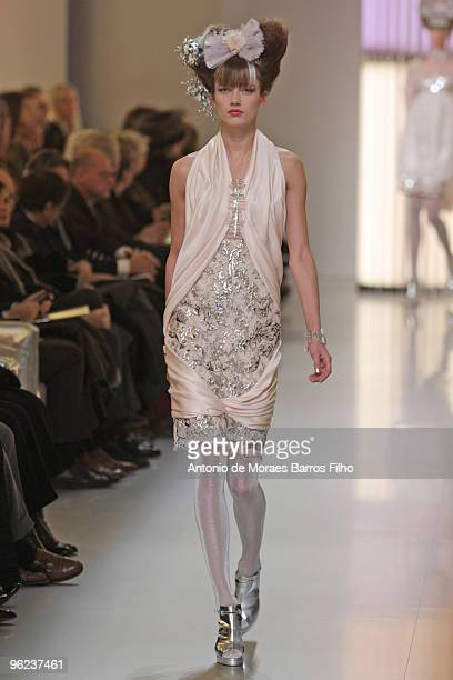 A model walks the runway during the Chanel HauteCouture show as part of the Paris Fashion Week Spring/Summer 2010 at Pavillon Cambon Capucines on...
