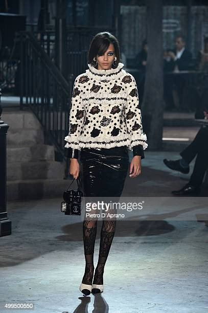 A model walks the runway during the Chanel Metiers d'Art 2015/16 Fashion Show at Cinecitta on December 1 2015 in Rome Italy