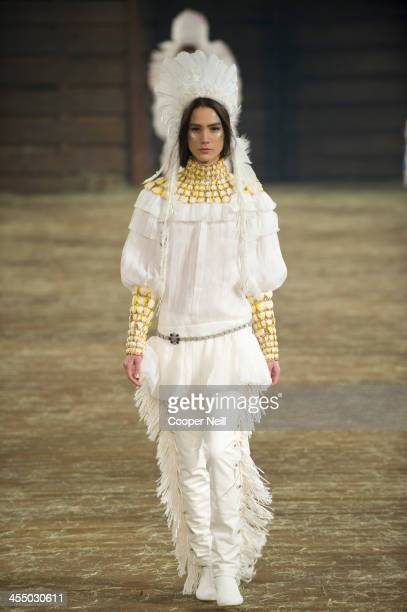 A model walks the runway during the Chanel 'Metiers d'Art' Show at Fair Park on December 10 2013 in Dallas Texas