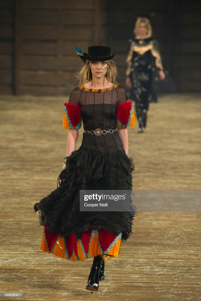 A model walks the runway during the Chanel 'Metiers d'Art' Show at Fair Park on December 10, 2013 in Dallas, Texas.