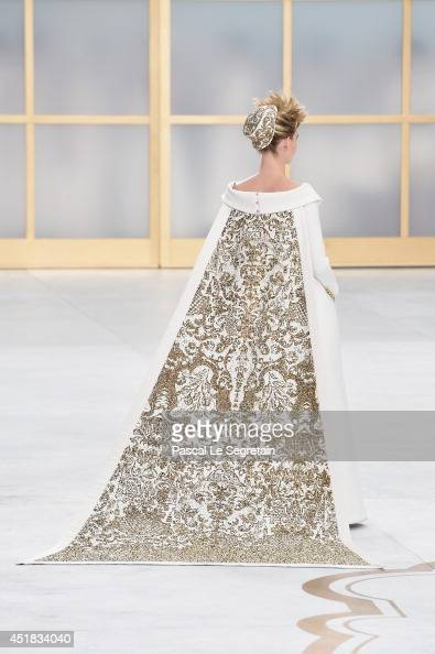 A model walks the runway during the Chanel show as part of Paris Fashion Week Haute Couture Fall/Winter 20142015 at Grand Palais on July 8 2014 in...
