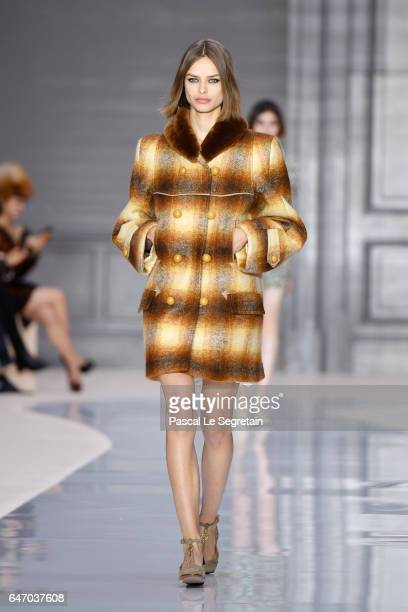 A model walks the runway during the Chloe show as part of the Paris Fashion Week Womenswear Fall/Winter 2017/2018 on March 2 2017 in Paris France