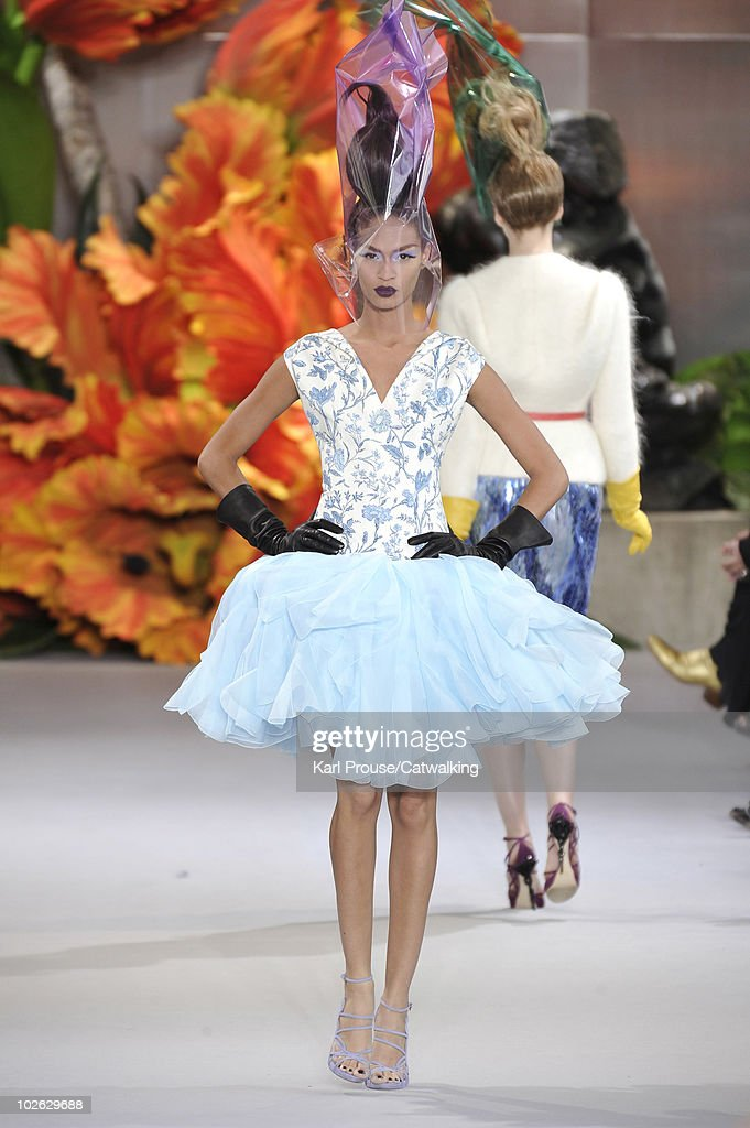 A model walks the runway during the Christian Dior fashion show at Paris Haute Couture Fashion Week for Autumn Winter 2010 on July 5, 2010 in Paris, France.
